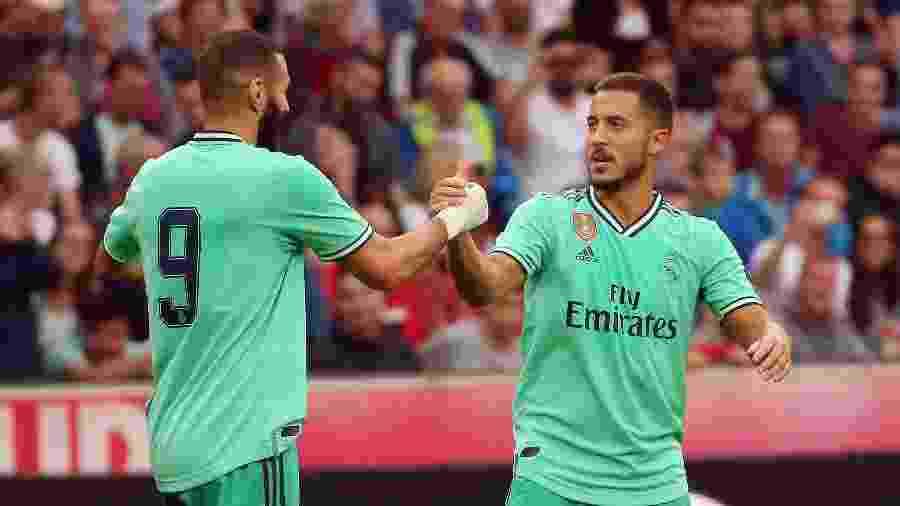 Benzema e Hazard comemoram gol do Real Madrid contra o Red Bull Salzburg - KRUGFOTO / APA / AFP