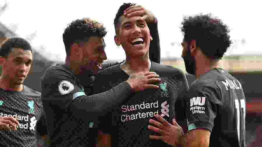 Roberto Firmino comemora gol do Liverpool diante do Southampton pelo Campeonato Inglês - Glyn Kirk/AFP