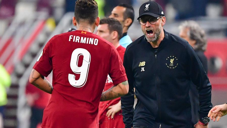 Técnico Jurgen Klopp comemora gol de Roberto Firmino para o Liverpool na final do Mundial de Clubes 2019 contra o Flamengo - Giuseppe Cacace/AFP