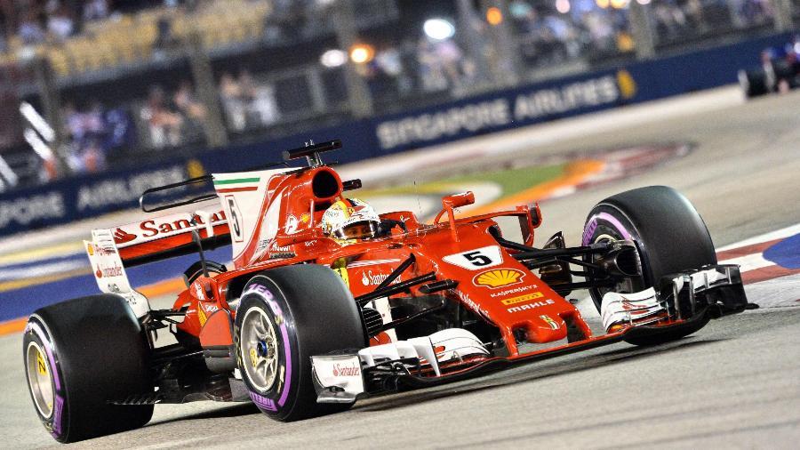 Sebastian Vettel, durante a classificação para o GP de Cingapura - AFP PHOTO / Roslan RAHMAN