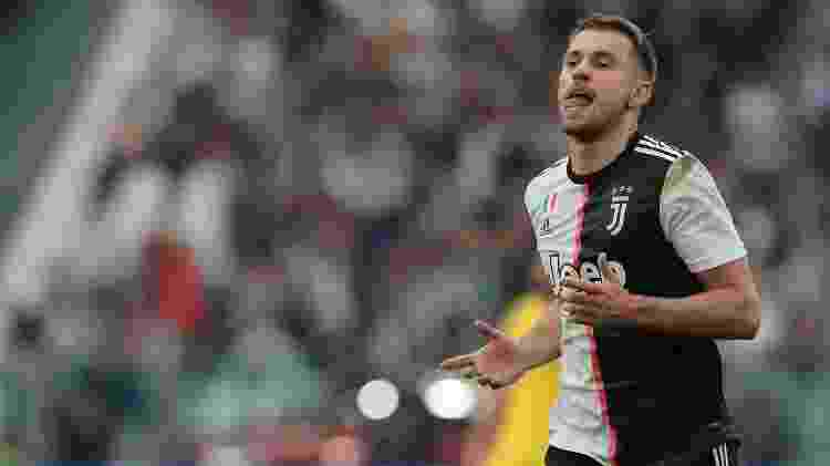Aaron Ramsey comemora após abrir o placar para a Juventus contra o Hellas Verona - Emilio Andreoli/Getty Images