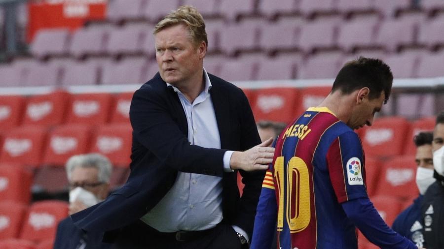 Ronald Koeman, técnico do Barcelona, e Lionel Messi - REUTERS/Albert Gea