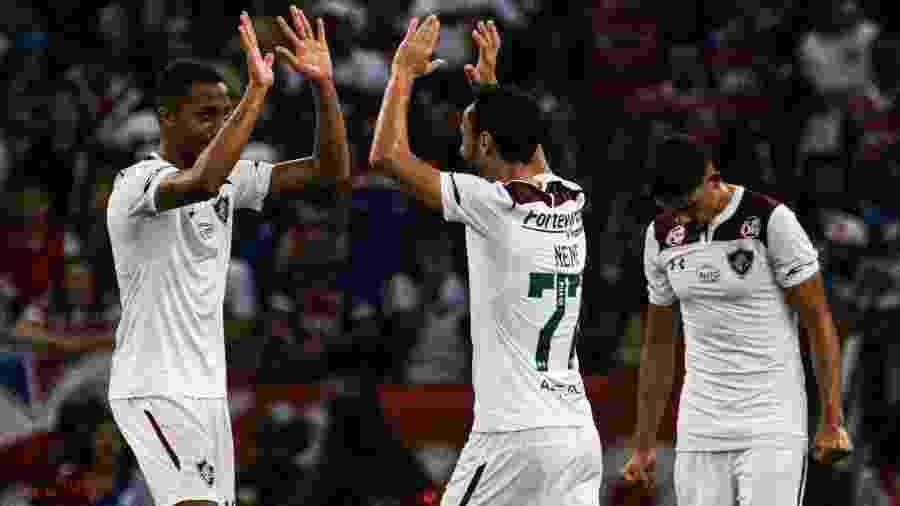 João Pedro comemora com Nenê gol da vitória do Fluminense na última visita ao Castelão - Ronaldo Silva/Estadão Conteúdo