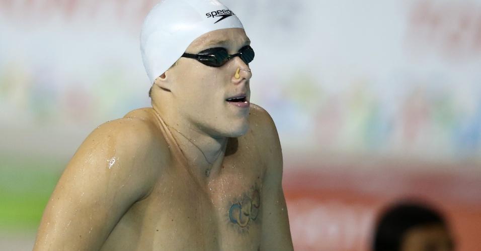 Brasileiro Henrique Rodrigues tem os anéis olímpicos tatuados no peito