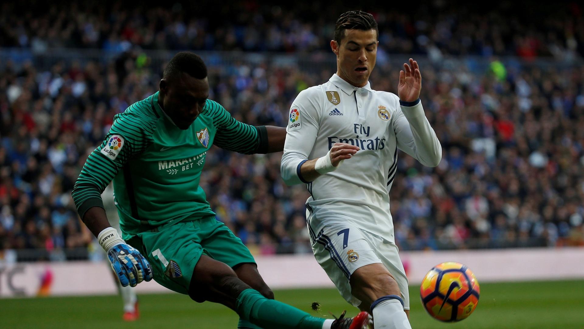 Cristiano Ronaldo em ação pelo Real Madrid em duelo contra o Málaga