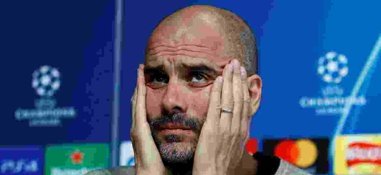 Pep Guardiola dá entrevista na véspera da partida entre Manchester City e Tottenham - Jason Cairnduff/Reuters