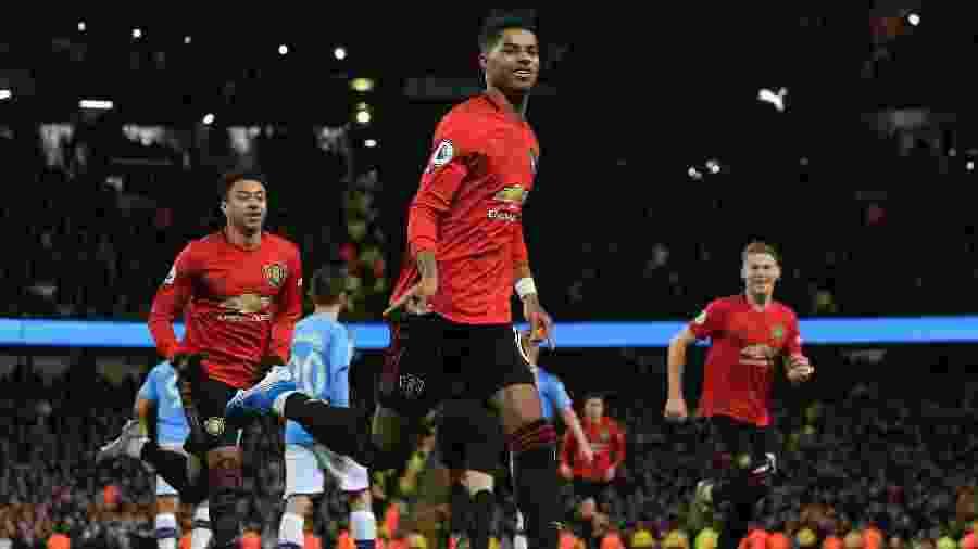 Rashford comemora gol contra o Manchester City - Lindsey Parnaby/AFP
