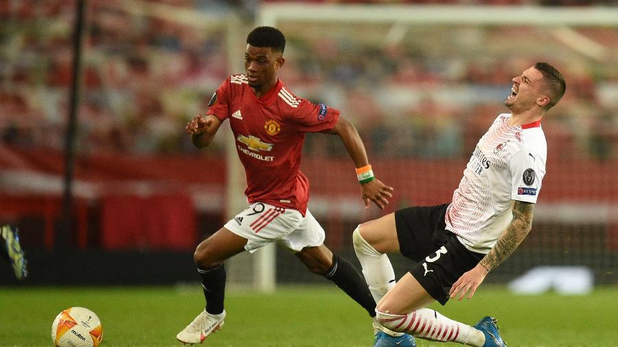 Manchester United e Milan empatam em 1 a 1 no jogo de ida das oitavas de final da Liga Europa - Oli SCARFF / AFP