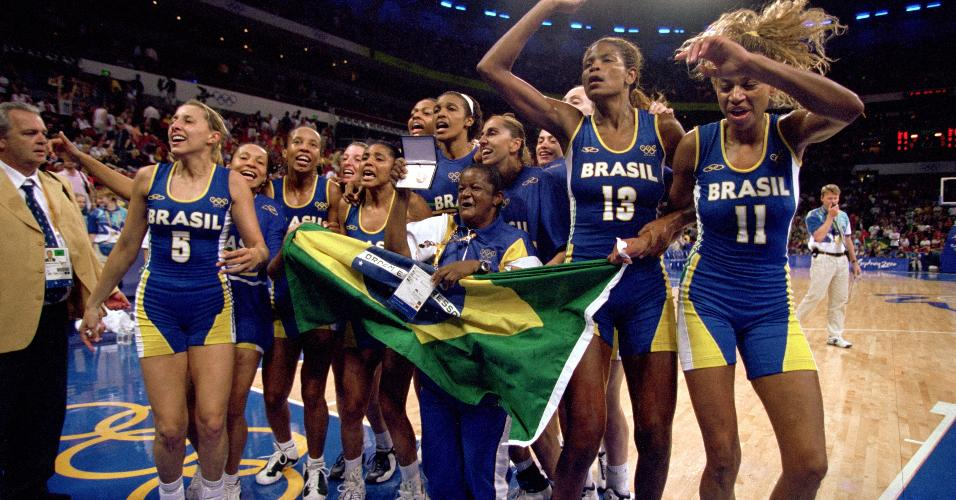 SYDNEY - SEPTEMBER 30:  Team Brazil celebrates capturing the bronze after the women's basketball medal game against Korea at the Sydney SuperDome during the Sydney Olympic Games in Sydney, Australia on September 30, 2000.  Brazil defeated Korea in overtime 84-73.  (Photo by Jamie Squire /Getty Images)