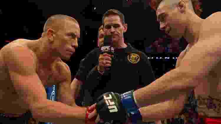 Georges St-Pierre e Dan Hardy, antes de luta no UFC 111 - Josh Hedges/Zuffa LLC via Getty Images - Josh Hedges/Zuffa LLC via Getty Images