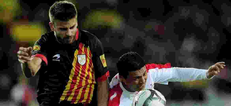 Piqué, durante partida pela Catalunha contra a Tunísia, em 2016 - AFP PHOTO/ JOSEP LAGO