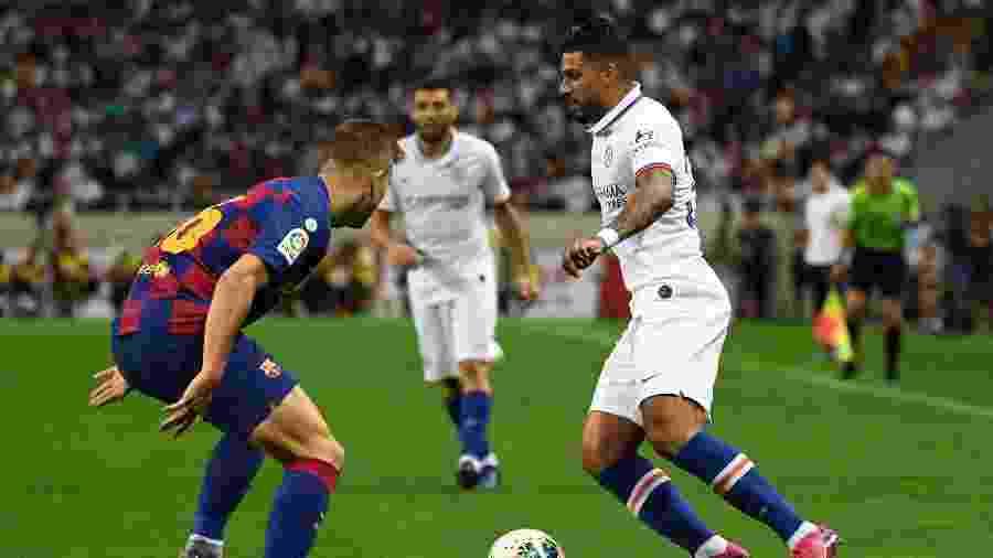 Emerson Palmieri durante amistoso contra o Barcelona - Toshifumi KITAMURA / AFP