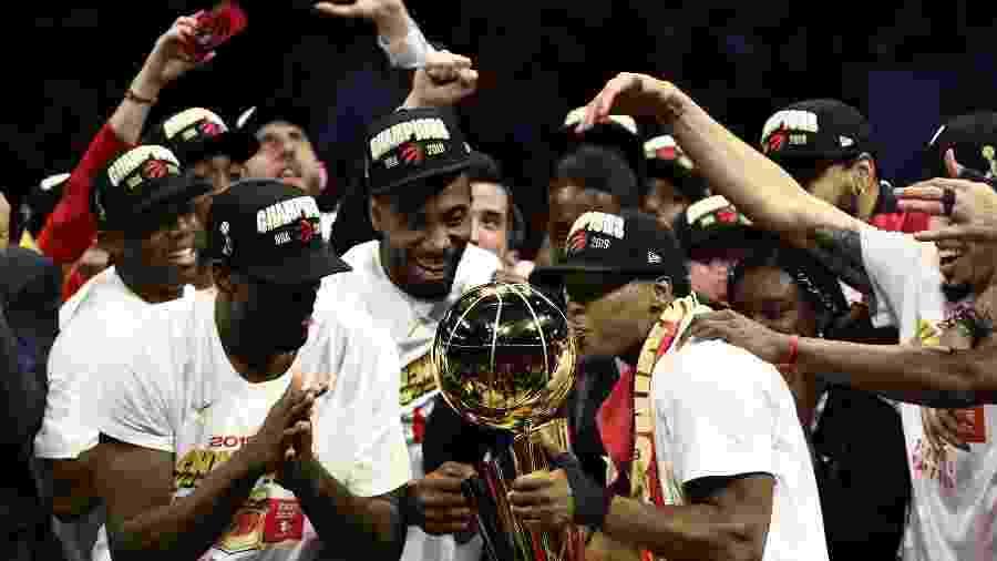 Jogadores do Toronto Raptors fazem a festa com título da NBA  - Ezra Shaw/Getty Images/AFP