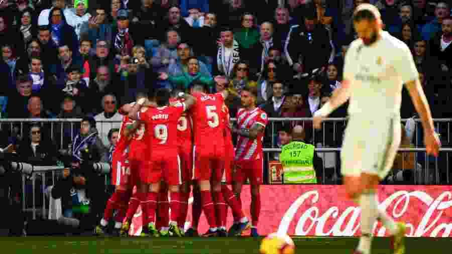 Jogadores do Girona comemoram gol em partida contra o Real Madrid - GABRIEL BOUYS/AFP