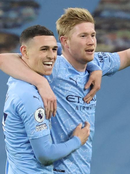 Kevin De Bruyne e Phil Foden celebram gol do City - CLIVE BRUNSKILL/AFP