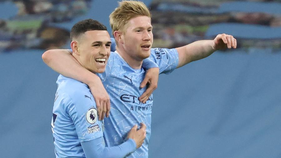 Kevin De Bruyne e Phil Foden celebram o primeiro gol do City - CLIVE BRUNSKILL/AFP
