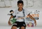 Vendedor de dindim sonha em ser jogador e entra no estádio pela 1ª vez - Lyvia Rocha/Tribuna do Ceará