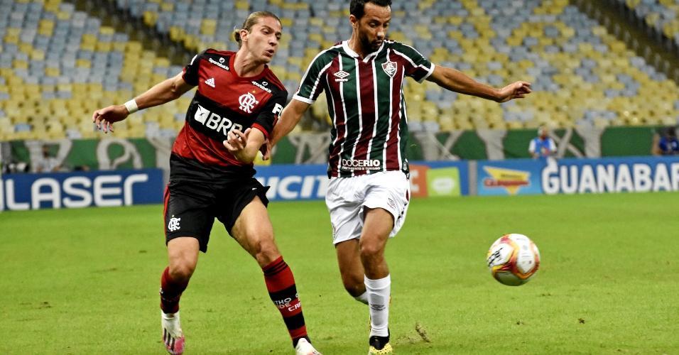 Filipe Luis, do Flamengo, acompanha Nenê, do Fluminense, na final da Taça Rio
