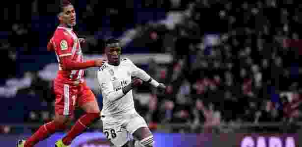 Vinicius Júnior em ação durante jogo do Real Madrid contra o Girona - Javier Soriano/AFP