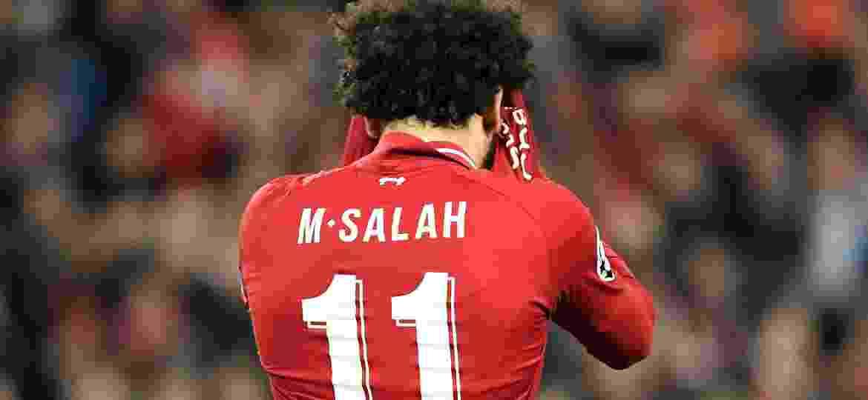 Salah não precisa se envergonhar: Liverpool torce para o rival Manchester United nesta quarta - LLUIS GENE / AFP