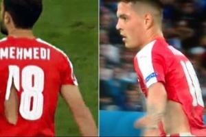 Dois jogadores da Suíça precisaram tiveram as camisas rasgadas na partida  deste domingo contra França 31fd6412b9642