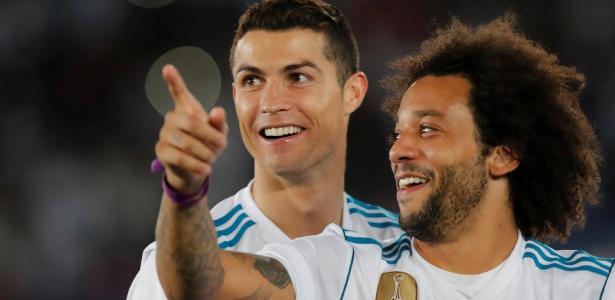 Cristiano Ronaldo comemora com Marcelo o sexto título mundial do Real Madrid