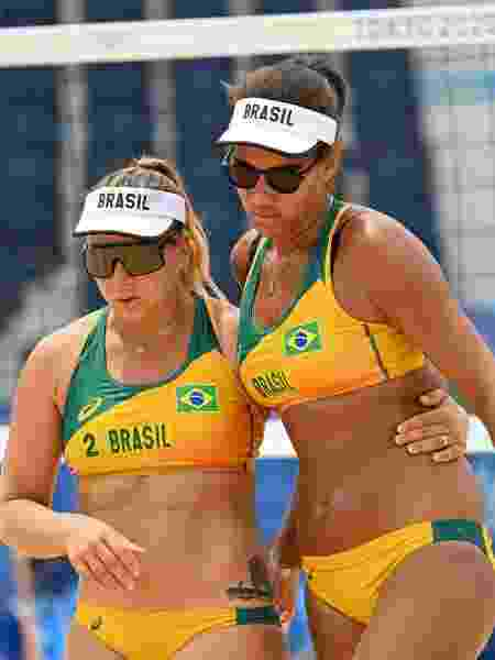 Ana Patrícia e Rebecca na estreia do vôlei de praia  - Angela WEISS / AFP - Angela WEISS / AFP