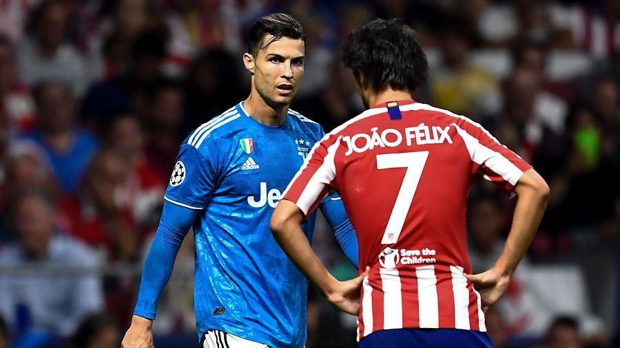 Cristiano Ronaldo, da Juventus, e João Félix, do Atlético de Madri, na Liga dos Campeões - OSCAR DEL POZO / AFP