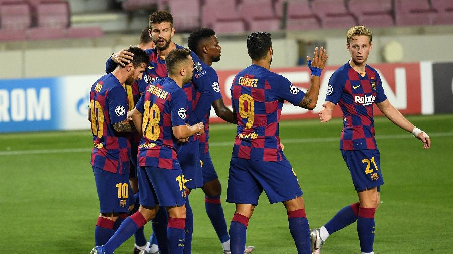 Jogadores do Barcelona comemoram gol de Messi sobre o Napoli - David Ramos/Getty Images