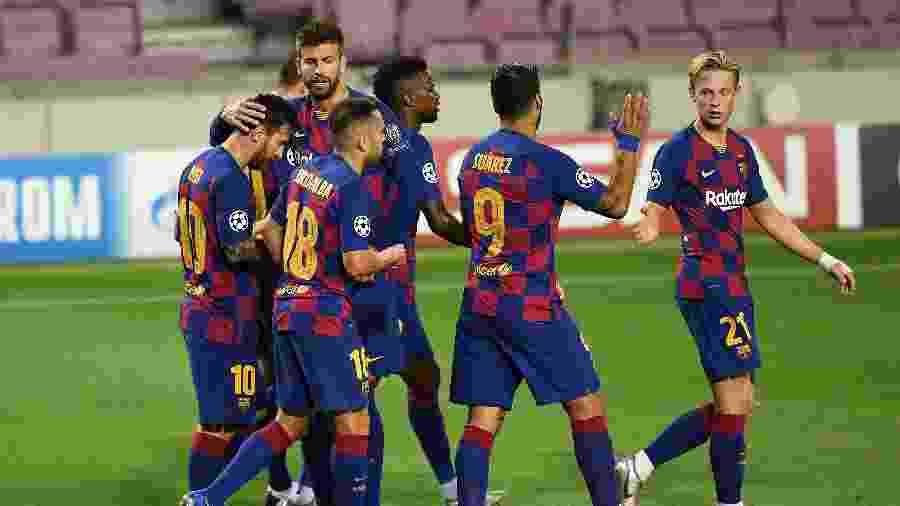 Jogadores do Barcelona comemoram gol de Messi sobre o Napoli - David Ramos/Getty Images