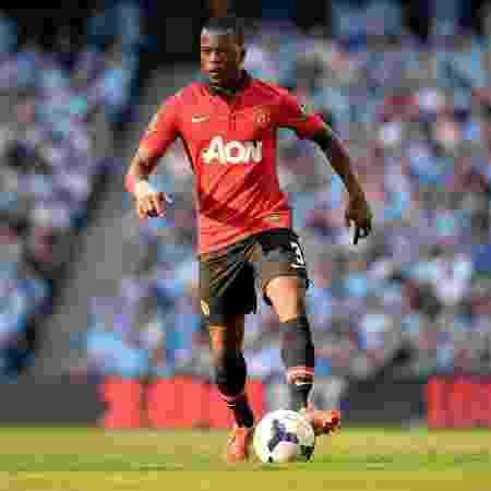 Patrice Evra jogou durante quase uma década com a camisa do United - PAUL ELLIS/AFP