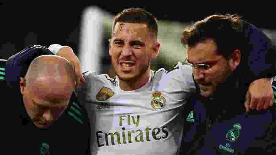 Eden Hazard sofre lesão em jogo pelo Real Madrid - GABRIEL BOUYS / AFP