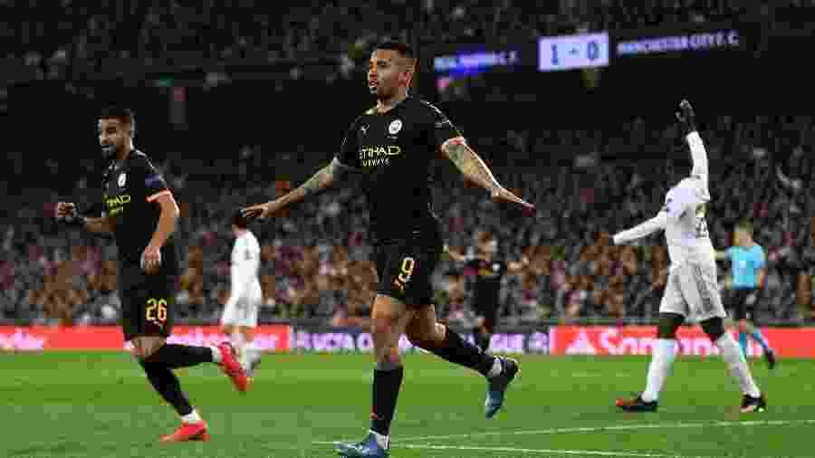 Gabriel Jesus comemora após marcar para o Manchester City contra o Real Madrid pela Liga dos Campeões - David Ramos/Getty Images