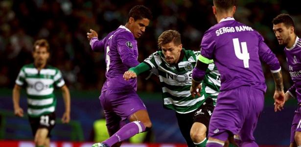 Silva passa por Varane e Sergio Ramos em jogo do Sporting contra o Real Madrid