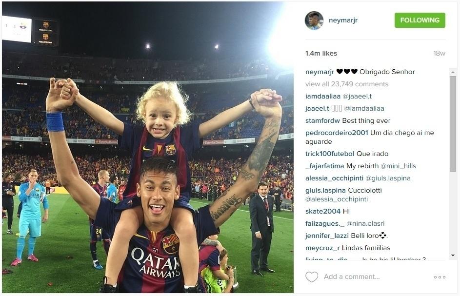 Neymar com o filho David Lucca, na comemoração da Liga dos Campeões