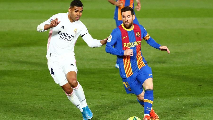 Marcado por Casemiro, Messi tenta fazer jogada no clássico entre Real Madrid e Barcelona - Sergio Perez/Reuters