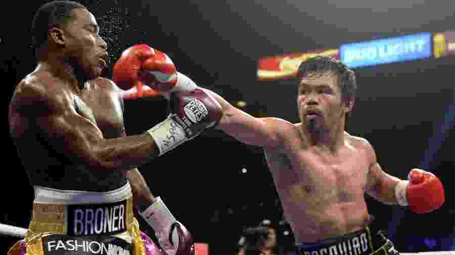 Manny Pacquiao (dir) vence Adrien Broner (esq)  - Joe Camporeale/USA TODAY Sports