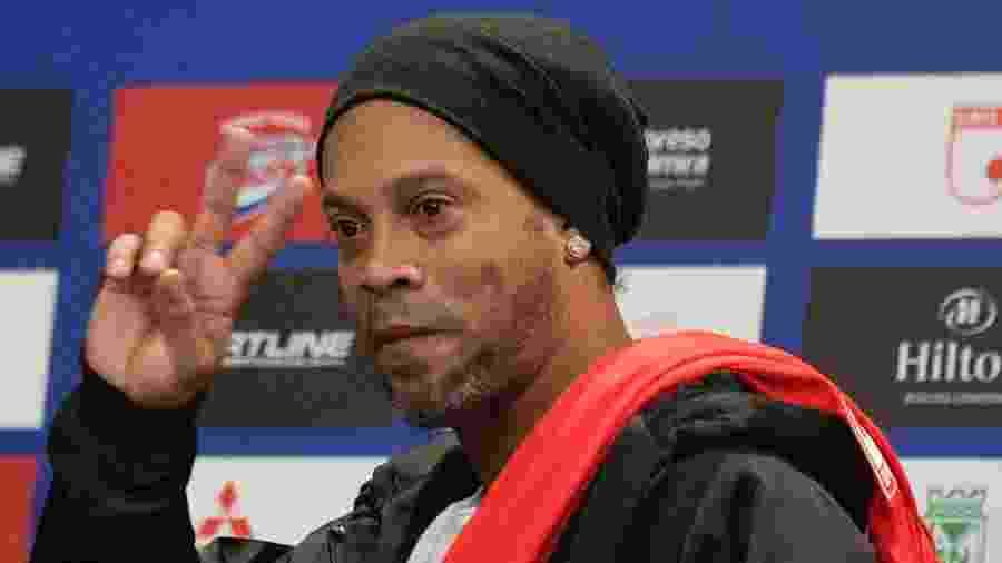 Ronaldinho Gaúcho diz que rompeu com a 18kRonaldinho após a empresa começar a trabalhar com Bitcoins - Raul ARBOLEDA / AFP