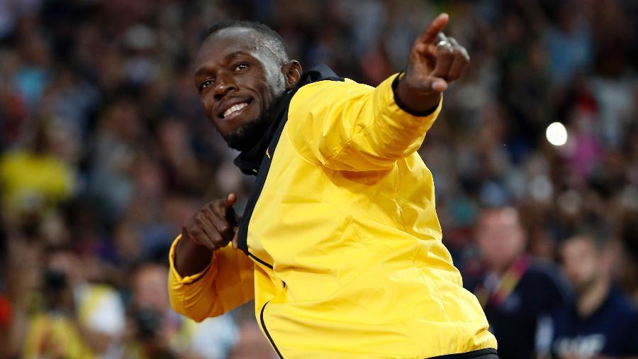 Usain Bolt faz seu famoso gesto em sua despedida no Mundial de Atletismo - Phil Noble/Reuters