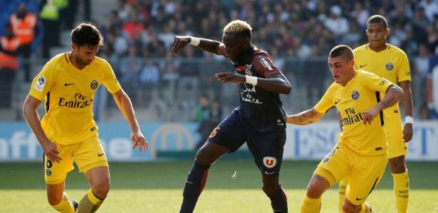 Motta (esq.) em ação contra o Montpellier