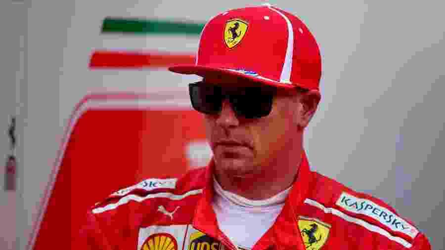 Kimi Raikkonen, piloto da Ferrari, antes de treino para o GP da Rússia - ANDREJ ISAKOVIC / AFP