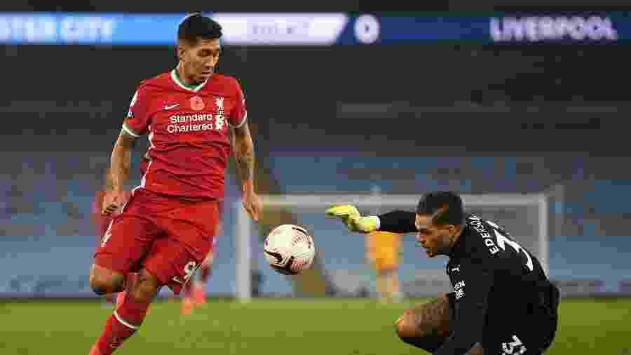 Firmino, do Liverpool, disputa lance com Ederson, do Manchester City - Shaun Botterill/Getty Images