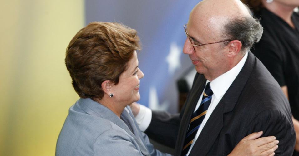 Em foto de 2010, Dilma Rousseff e o então presidente do BC, Henrique Meirelles, no Palácio do Planalto durante cerimônia de Registro do Balanço de Governo 2003-–2010
