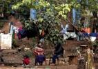 Em luta por terra, aldeias do Jaraguá convivem com sujeira e doenças (Foto: Miguel Schinchariol/AFP)