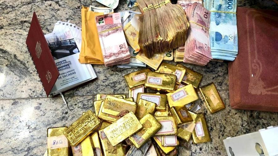 Barras de ouro, notas de dinheiro e documentos apreendidos durante operação da PF no Pará - Divulgação/PF
