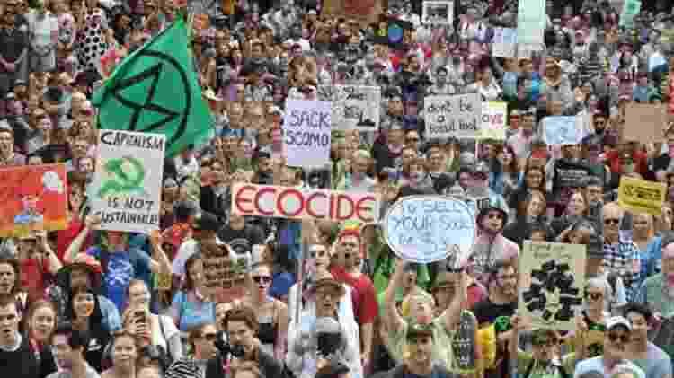 Na Austrália, afetada por fortes incêndios florestais, manifestantes cobram do governo ações contra as mudanças climáticas - AFP