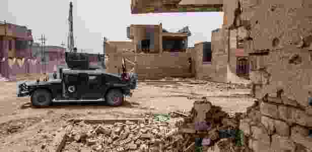 18.jun.2016 - Forças antiterrorismo iraquianas avançam pelo distrito de Shudada, em Fallujah (Iraque) - Bryan Denton/The New York Times - Bryan Denton/The New York Times