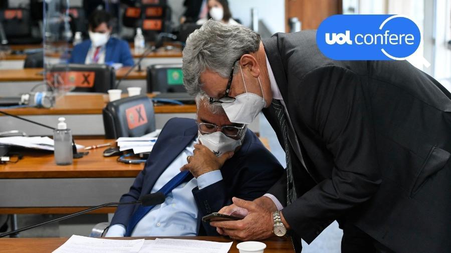 18.mai.2021 - Os senadores Eduardo Girão (Podemos-CE, sentado) e Luis Carlos Heinze (PP-RS, de pé) na CPI da Covid no Senado - Jefferson Rudy/Agência Senado