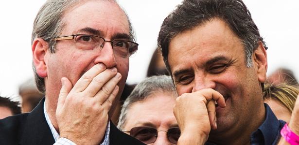 1.mai.2015 - O presidente da Câmara, Eduardo Cunha (PMDB-RJ), com o senador Aécio Neves (PSDB-MG), em palanque da Força Sindical no Dia do Trabalho
