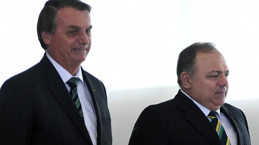 Bolsonaro e Pazuello em lançamento do Programa Nacional de Imunização contra covid-19 - EDU ANDRADE/FATOPRESS/ESTADÃO CONTEÚDO